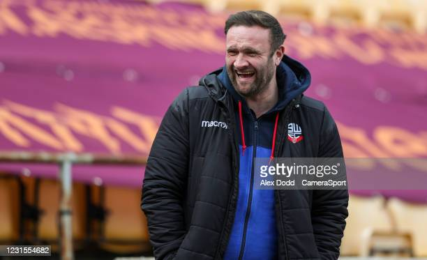 Bolton Wanderers manager Ian Evatt shares a joke with a friend before the warm-up during the Sky Bet League Two match between Bradford City and...
