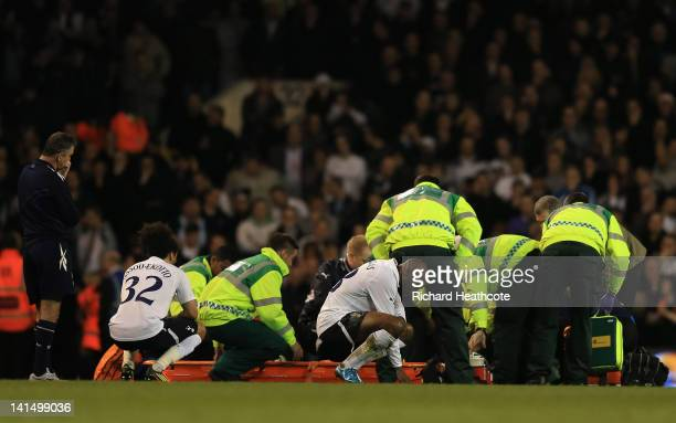 Bolton Wanderers manager Owen Coyle and players look on distraught as Fabrice Muamba of Bolton Wanderers receives CPR treatment on the pitch after...