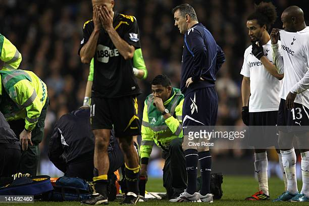 Bolton Wanderers manager Owen Coyle Benoit AssouEkotto and William Gallas of Tottenham Hotspur look concerned as Darren Pratley of Bolton Wanderers...