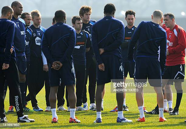 Bolton Wanderers manager Owen Coyle speaks to his players during a training session at their Euxton training ground near Bolton northwest England on...