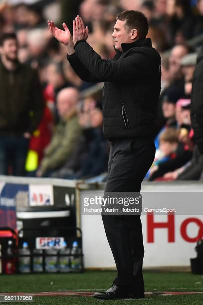 Bolton Wanderers manager Phil Parkinson applauds during the Sky Bet League One match between Fleetwood Town and Bolton Wanderers at Highbury Stadium...