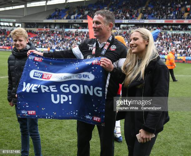 Bolton Wanderers manager Phil Parkinson applauds the fans as the team parade the trophy around the pitch celebrating their promotion to the EFL...
