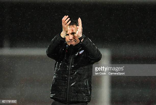 Bolton Wanderers manager Phil Parkinson applauds the travelling Bolton fans at the final whistle during the Checkatrade Trophy Northern Group A match...
