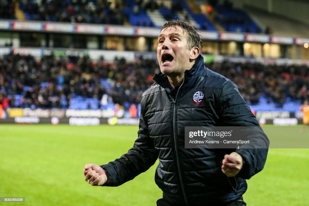 Bolton Wanderers' manager Phil Parkinson celebrates victory at the end of the match during the Sky Bet Championship match between Bolton Wanderers and Hull City at Macron Stadium on January 1, 2018 in Bolton, England.