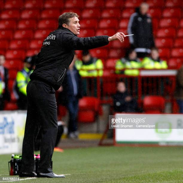 Bolton Wanderers manager Phil Parkinson shouts instructions to his team from the dugout during the Sky Bet League One match between Sheffield United...