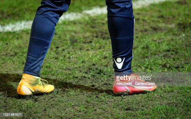 Bolton Wanderers' Marcus Maddison warms up, with odd boots during the Sky Bet League Two match between Oldham Athletic and Bolton Wanderers at...