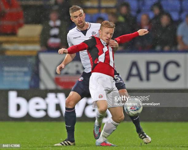 Bolton Wanderers' Mark Beevers andSheffield United's George Baldock during the Sky Bet Championship match between Bolton Wanderers and Sheffield...