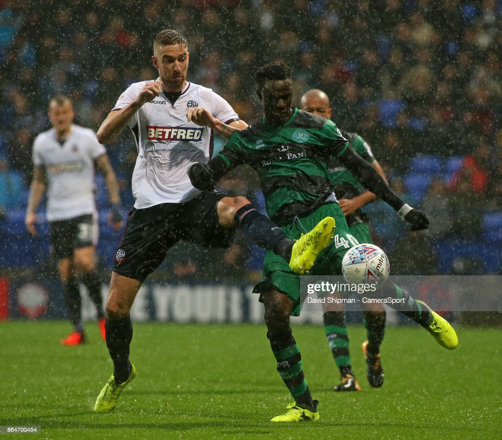 Bolton Wanderers' Mark Beevers battles with Queens Park Rangers' Idrissa Sylla during the Sky Bet Championship match between Bolton Wanderers and Queens Park Rangers at Macron Stadium on October 21, 2017 in Bolton, England.