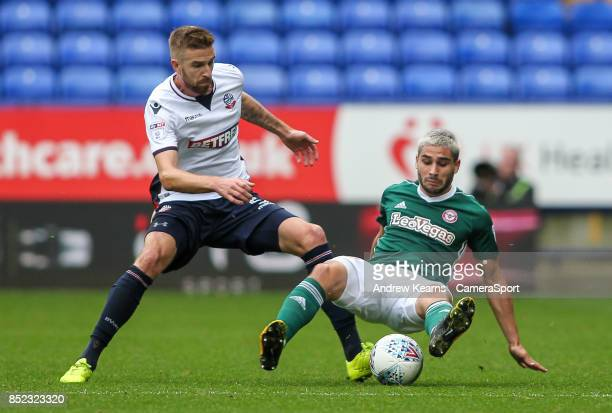 Bolton Wanderers' Mark Beevers competing with Brentford's Neal Maupay during the Sky Bet Championship match between Bolton Wanderers and Brentford at...