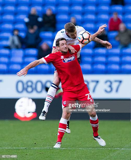 Bolton Wanderers' Mark Beevers heads the ball under pressure from Scott Vernon of Grimsby Town during the The Emirates FA Cup 1st Round match between...