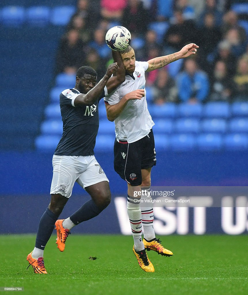 Bolton Wanderers' Mark Beevers vies for possession with Southend United's Jason Williams during the Sky Bet League One match between Bolton Wanderers and Southend United at Macron Stadium on September 3, 2016 in Bolton, England.