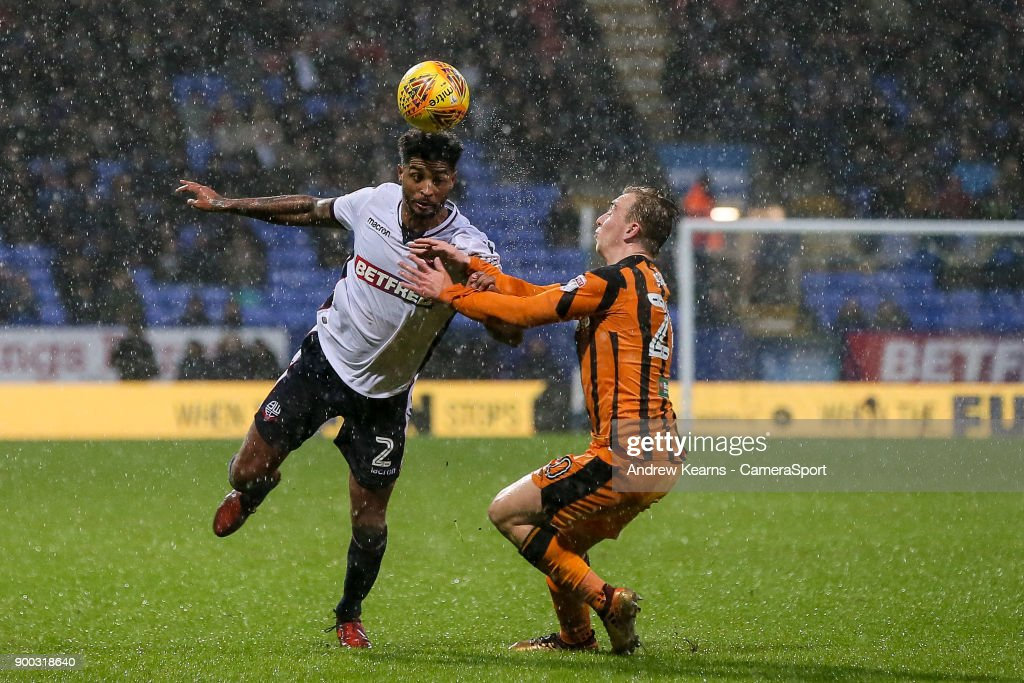 Bolton Wanderers' Mark Little competing with Hull City's Jarrod Bowen during the Sky Bet Championship match between Bolton Wanderers and Hull City at Macron Stadium on January 1, 2018 in Bolton, England.