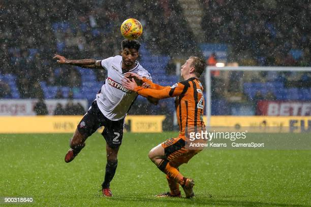 Bolton Wanderers' Mark Little competing with Hull City's Jarrod Bowen during the Sky Bet Championship match between Bolton Wanderers and Hull City at...
