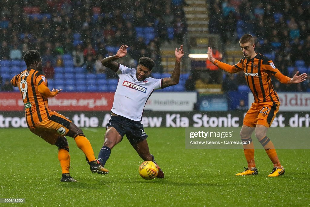 Bolton Wanderers' Mark Little competing with Hull City's Nouha Dicko during the Sky Bet Championship match between Bolton Wanderers and Hull City at Macron Stadium on January 1, 2018 in Bolton, England.