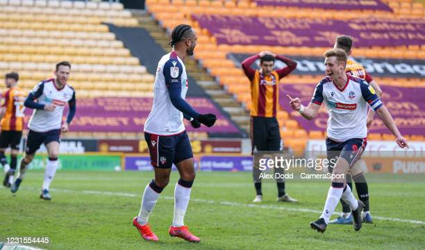 Bolton Wanderers' Nathan Delfouneso celebrates scoring the opening goal with Eoin Doyle during the Sky Bet League Two match between Bradford City and...