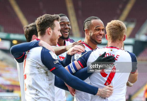 Bolton Wanderers' Nathan Delfouneso celebrates scoring the opening goal with teammates during the Sky Bet League Two match between Bradford City and...