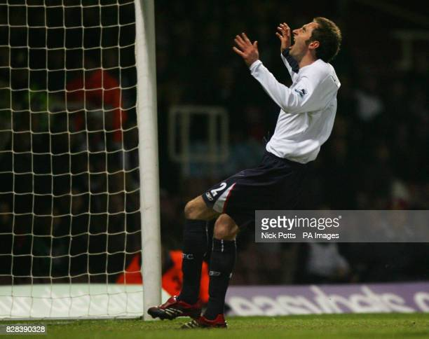 Bolton Wanderers' Nicky Hunt shows his dejection after scoring an own goal against West Ham United during the FA Cup fifth round replay match at...