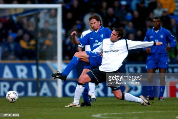 Bolton Wanderers' Paul Warhurst tackles Chelsea's Emmanuel Petit