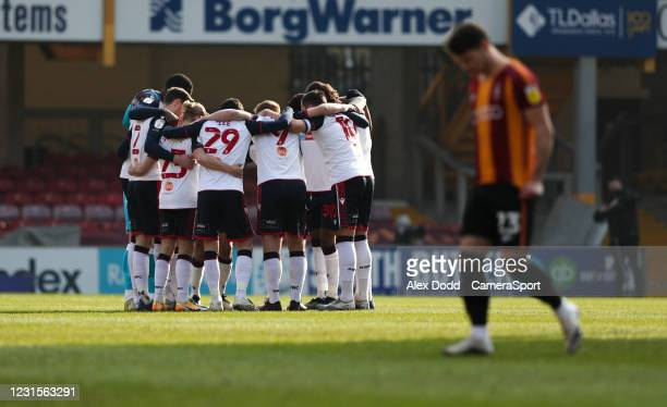 Bolton Wanderers players huddle up before the match during the Sky Bet League Two match between Bradford City and Bolton Wanderers at Northern...