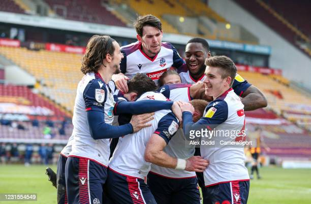 Bolton Wanderers players mob Nathan Delfouneso after he scored a late opening goal during the Sky Bet League Two match between Bradford City and...