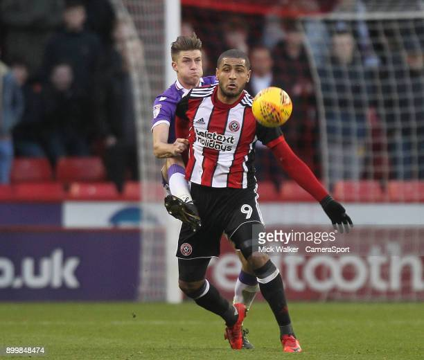 Bolton Wanderers Reece Burke battles with Sheffield United's Leon Clarke during the Sky Bet Championship match between Sheffield United and Bolton...