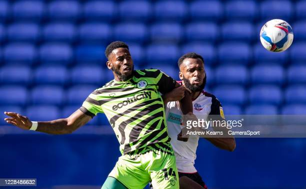 Bolton Wanderers' Reiss Greenidge competing with Forest Green Rovers' Jamille Matt during the Sky Bet League Two match between Bolton Wanderers and...