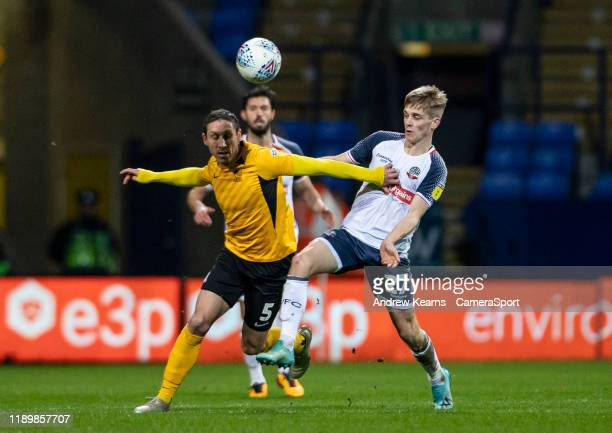 Bolton Wanderers' Ronan Darcy competing with Southend United's Mark Milligan during the Sky Bet League One match between Bolton Wanderers and...