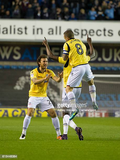 Bolton Wanderers' Sammy Ameobi celebrates scoring the opening goal with Lawrie Wilson and Jay Spearing during the Sky Bet League One match between...