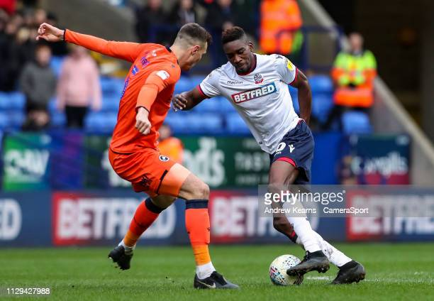 Bolton Wanderers' Sammy Ameobi competing with Millwall's Jake Cooper during the Sky Bet Championship match between Bolton Wanderers and Millwall at...