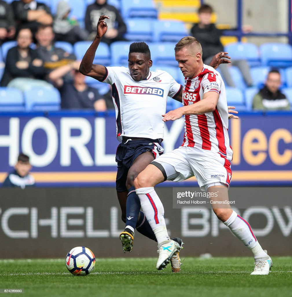 Bolton Wanderers' Sammy Ameobi competing with Stoke City's Ryan Shawcross during the pre-season friendly match between Bolton Wanderers and Stoke City at Macron Stadium on July 29, 2017 in Bolton, England.
