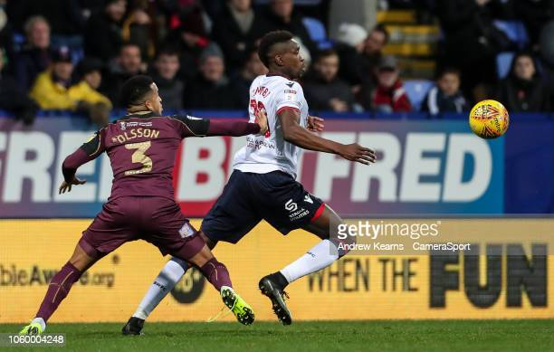 Bolton Wanderers' Sammy Ameobi competing with Swansea City's Martin Olsson during the Sky Bet Championship match between Bolton Wanderers and Swansea...