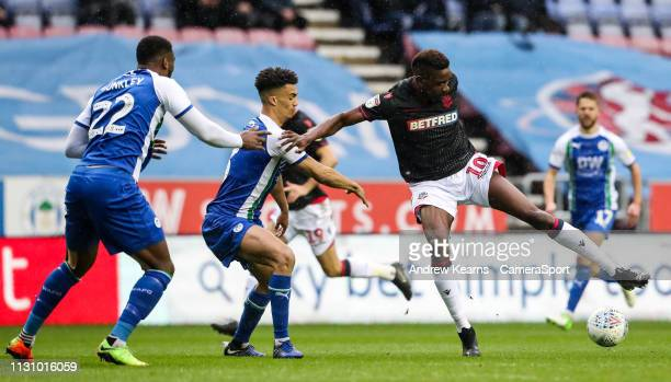 Bolton Wanderers' Sammy Ameobi competing with Wigan Athletic's Antonee Robinson during the Sky Bet Championship match between Wigan Athletic and...
