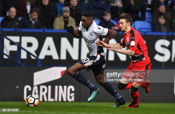 Bolton Wanderers' Sammy Ameobi holds off Huddersfield Town's Scott Malone during the FA Cup third round match at the Macron Stadium Bolton