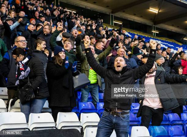 Bolton Wanderers' supporters celebrate scoring their first goal during the Sky Bet League One match between Coventry City and Bolton Wanderers at St...