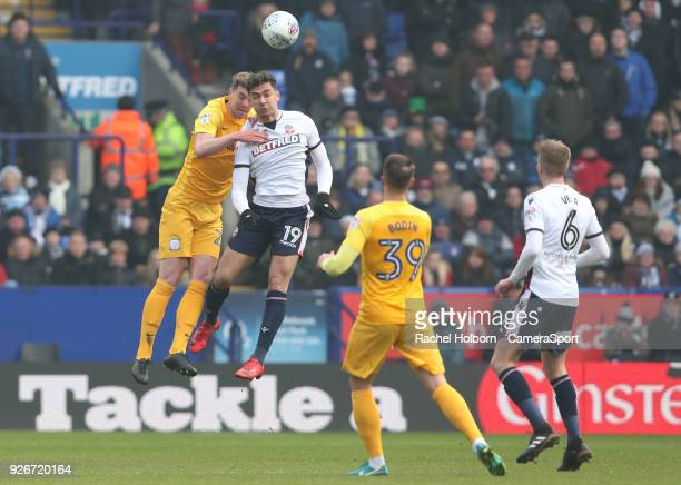 Bolton Wanderers' Tyler Walker and Preston North End's Paul Huntington head the ball during the Sky Bet Championship match between Bolton Wanderers...
