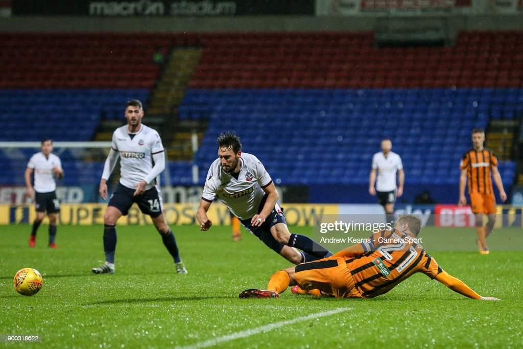 Bolton Wanderers' Will Buckley is brought down just outside the penalty area by Hull City's Michael Dawson during the Sky Bet Championship match between Bolton Wanderers and Hull City at Macron Stadium on January 1, 2018 in Bolton, England.