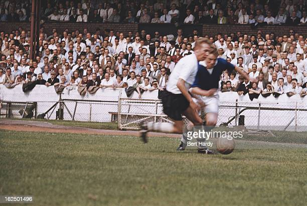 Bolton Wanderers winger Doug Holden in action, during a match against Chelsea at Stamford Bridge, London, 10th April 1954. Bolton Wanderers won the...