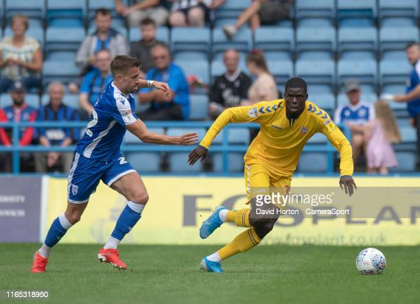 Bolton Wanderers' Yoan Zouma under pressure from Gillingham's Olly Lee during the Sky Bet League One match between Gillingham and Bolton Wanderers at...