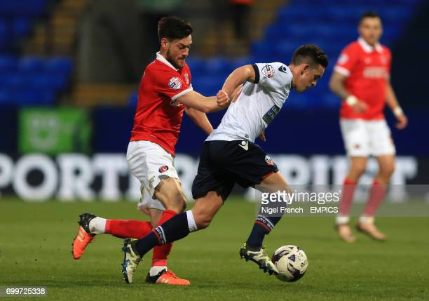 Bolton Wanderers' Zach Clough and Charlton Athletic's Johnnie Jackson battle for the ball