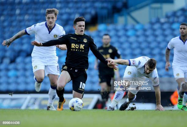 Bolton Wanderers' Zach Clough is fouled by Leeds United's Gaetano Berardi