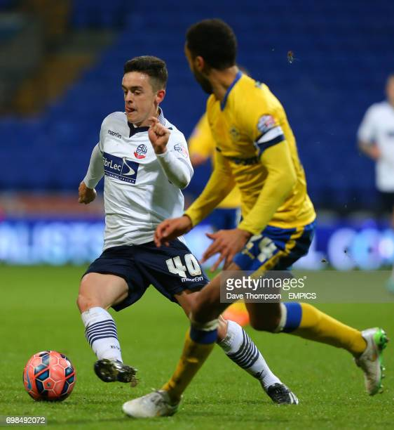 Bolton Wanderers' Zach Clough runs at the Wigan Athletic defence