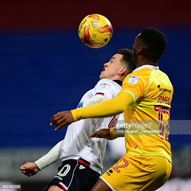 Bolton Wanderers' Zach Clough vies for possession with Millwall's Mahlon Romeo during the Sky Bet League One match between Bolton Wanderers and...