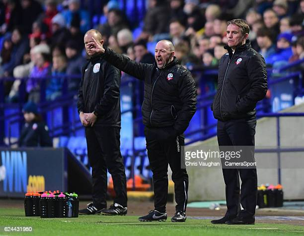 Bolton Wanderers's assistant manager Steve Parkin left and Bolton Wanderers manager Phil Parkinson shouts instructions to their team from the dugout...