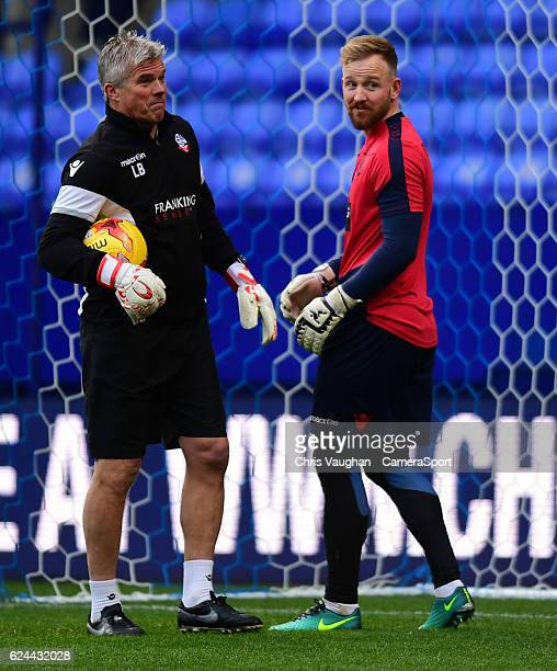 Bolton Wanderers's goalkeeping coach Lee Butler left and Bolton Wanderers' Ben Alnwick during the prematch warmup before the Sky Bet League One match...