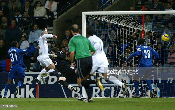 Bolton Wanderers's Stelios heads home past Arsenal's goalkeeper Manuel Almunia to make it 1-0 during their premiership match at the Reebok Stadium in...