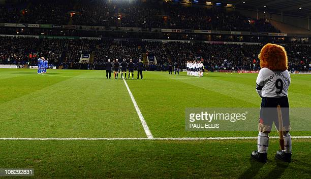 Bolton Wandrers mascot 'Lofty' watches as Chelsea and Bolton Wanderers players observe a minute of silence following the death of former Bolton and...