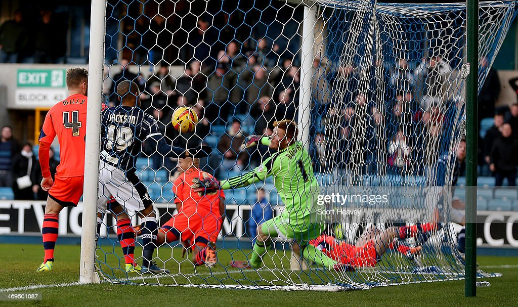 Bolton's Adam Bogdan looks back as Millwall score their equaliser during the Sky Bet Championship match between Millwall and Bolton Wanderers at The Den on February 15, 2014 in London, England.