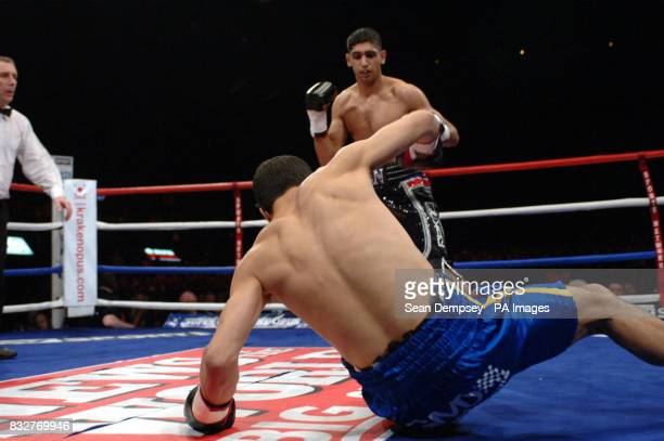 Bolton's Amir Khan knocks down France's Mohammed Medjani during the LightWelterweight fight at the Wembley Arena London