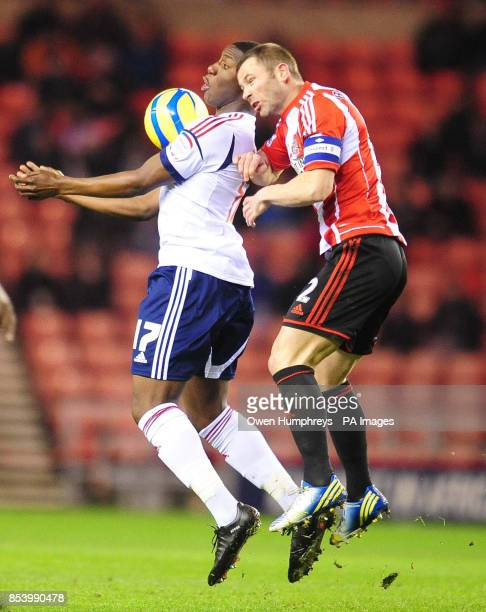 Bolton's Benik Afobe and Sunderland's Phil Bardsley in action during the FA Cup Third Round Replay at the Stadium of Light Sunderland