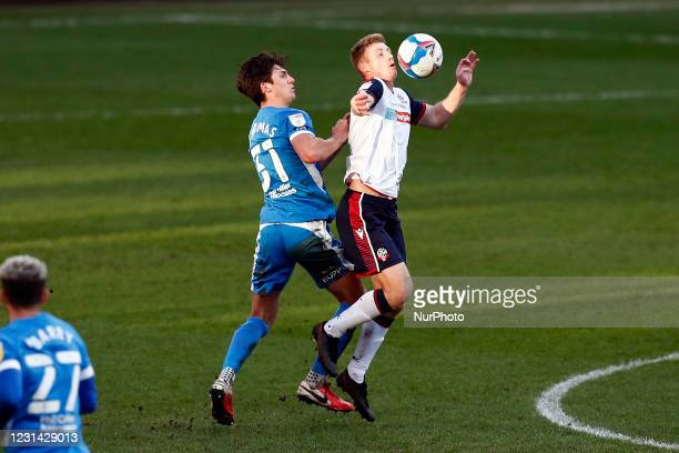 Boltons Eoin Doyle holds off Barrows Bobby Thomas during the Sky Bet League 2 match between Bolton Wanderers and Barrow at the Reebok Stadium, Bolton...